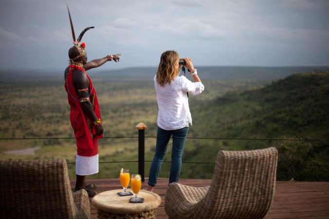Loisaba Tented camp deck view with Masai Warrior_1